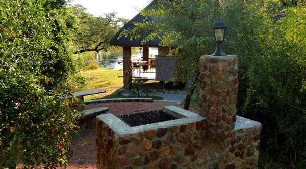 BBQ area and chalet directly at the Okavango