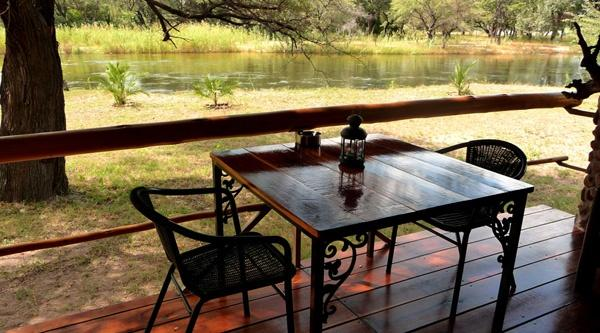 Terrace directly at the Okavango